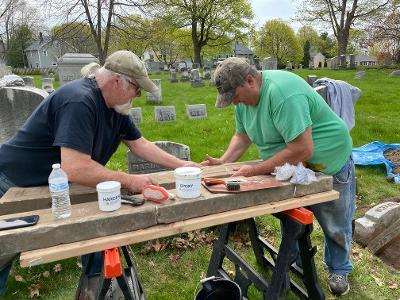 Bill and Tom repairing a cradle grave in Mount Hope Cemetery.