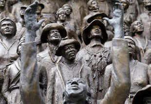sculpture of people celebrating emancipation