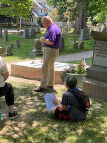 Dennis Carr with visitors at Douglass gravesite