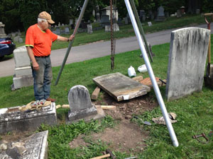 Reseeting a toppled gravestone