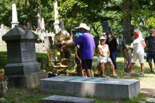 visitors at Douglass gravesite
